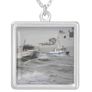 Crews from the coast guard and police departmen silver plated necklace