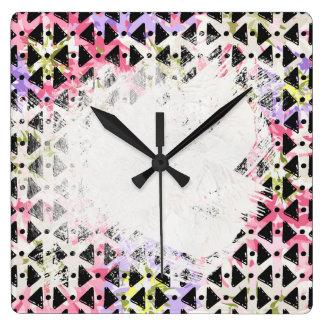Criss cross diamond shaped colourful patterned wall clocks