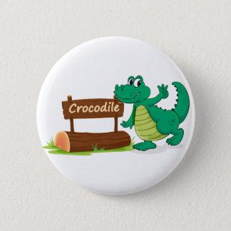 crocodile and name plate 6 cm round badge