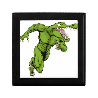 Crocodile or alligator  mascot running small square gift box