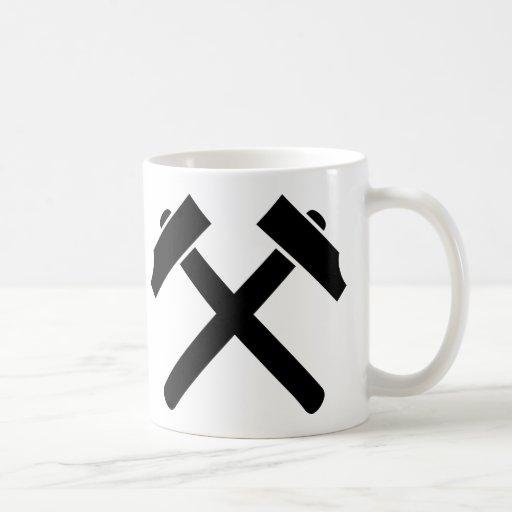 Crossed black hammer coffee mugs
