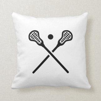 Crossed lacrosse sticks ball throw pillow