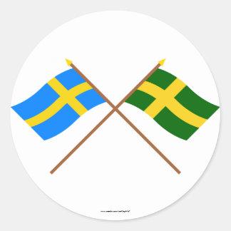 Crossed Sweden and Öland landskap flags Round Sticker