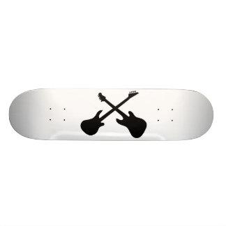 Crossing guitars skate board decks