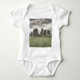 Crow in front of Stonehenge, England Baby Bodysuit