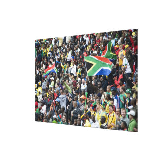 Crowd shot at a soccer game, with South African Canvas Print