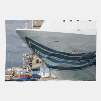 Cruise ship moored in a harbor towel