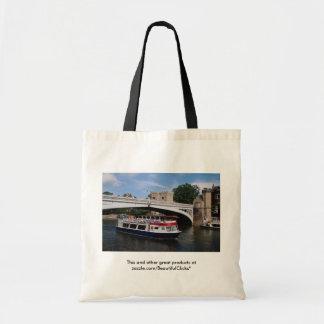 Cruiser passing under, Lendal Bridge, York, U.K. Tote Bag