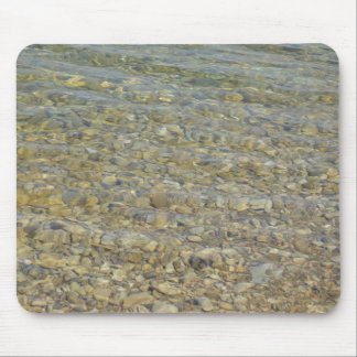 Crystal clear lake water with gravelly beach mouse pad