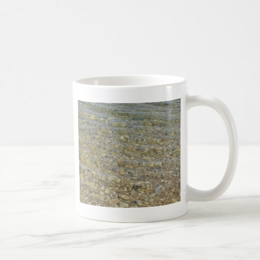 Crystal clear lake water with gravelly beach coffee mugs