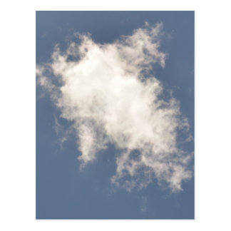 Cumulus Cloud floating in a bright Blue Sky. Postcard