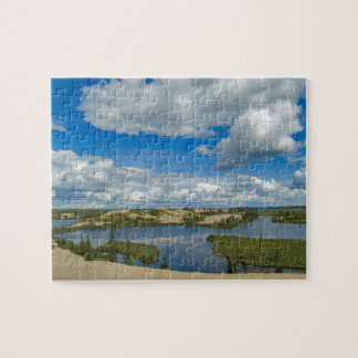 Cumulus clouds float above lakes, Northwest Jigsaw Puzzle