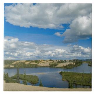 Cumulus clouds float above lakes, Northwest Tile