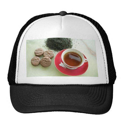 Cup of black tea with chocolate biscuits hats
