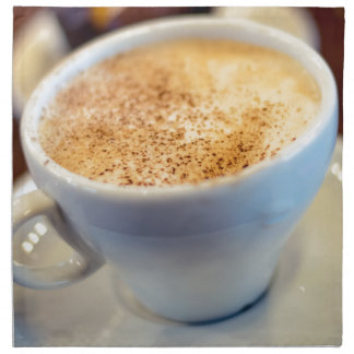 Cup of cappuccino napkin