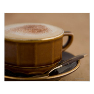 Cup of cappuccino with cocoa powder poster
