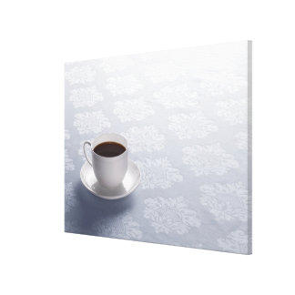 cup of coffee on table canvas print