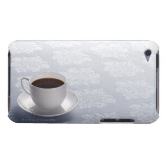 cup of coffee on table iPod touch cover