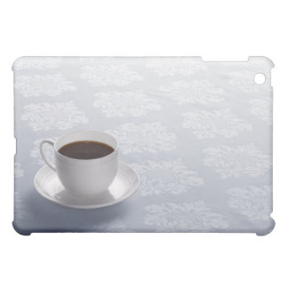 cup of coffee on table iPad mini covers