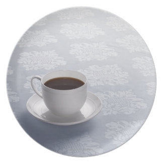 cup of coffee on table plate
