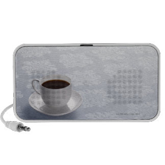 cup of coffee on table laptop speakers
