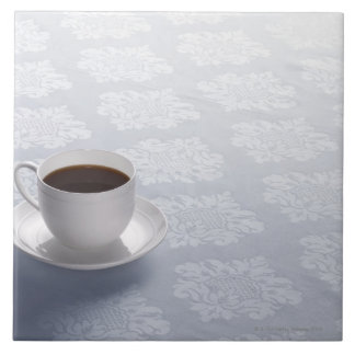 cup of coffee on table tile