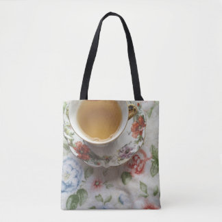 Cup of tea on floral fabric tote bag