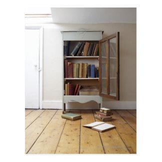 Cupboard full of books. postcard