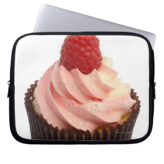 Cupcake topped with raspberry cream and a fresh computer sleeves