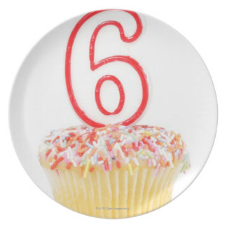 Cupcake with a numbered birthday candle 4 dinner plates