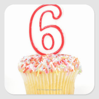 Cupcake with a numbered birthday candle 4 square sticker