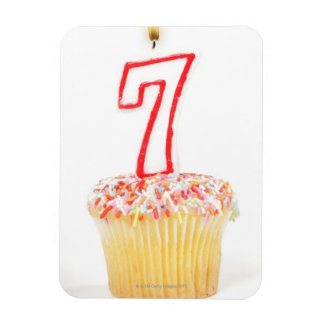 Cupcake with a numbered birthday candle 7 rectangular photo magnet