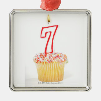 Cupcake with a numbered birthday candle 7 Silver-Colored square decoration