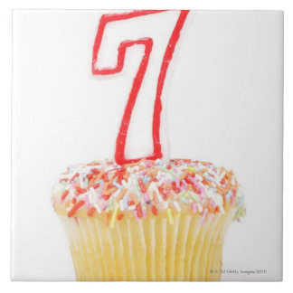 Cupcake with a numbered birthday candle 7 tile
