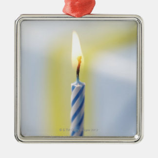 Cupcake with candle, close-up (focus on flame) Silver-Colored square decoration