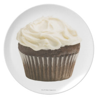 Cupcake with chocolate icing, studio shot 2 dinner plates