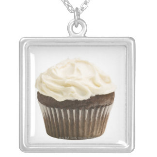 Cupcake with chocolate icing, studio shot 2 silver plated necklace