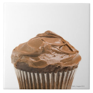 Cupcake with chocolate icing, studio shot large square tile