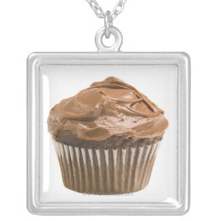 Cupcake with chocolate icing, studio shot silver plated necklace