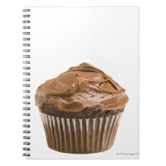 Cupcake with chocolate icing, studio shot spiral notebooks