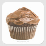 Cupcake with chocolate icing, studio shot square sticker
