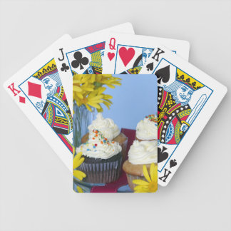 Cupcakes agains blue playing cards