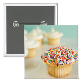 Cupcakes, focus on one in front with 15 cm square badge