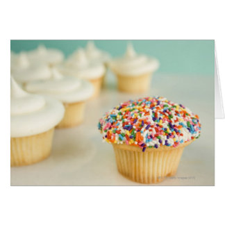 Cupcakes, focus on one in front with greeting card