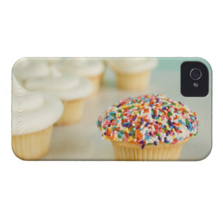 Cupcakes, focus on one in front with iPhone 4 cover