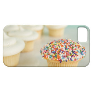 Cupcakes, focus on one in front with iPhone 5 cover