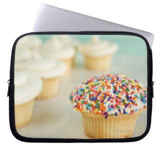 Cupcakes, focus on one in front with laptop computer sleeve