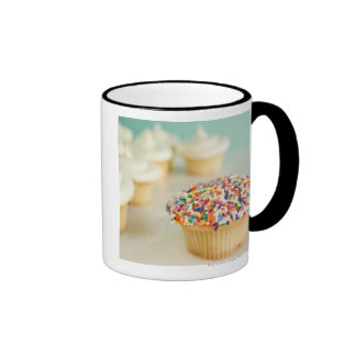 Cupcakes, focus on one in front with coffee mug