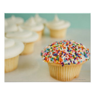 Cupcakes, focus on one in front with poster