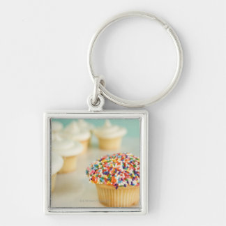 Cupcakes, focus on one in front with Silver-Colored square key ring